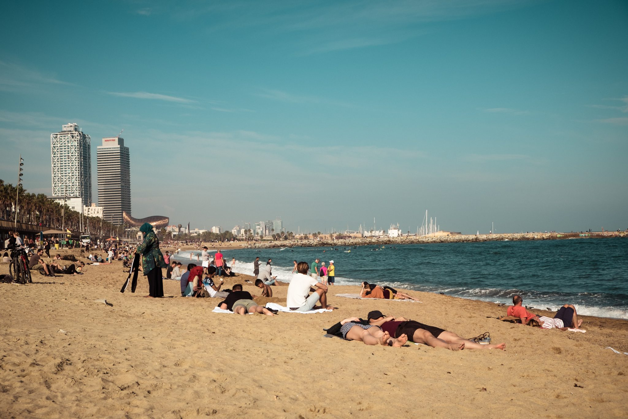 People relaxing on the beach photo by Jo Kassis