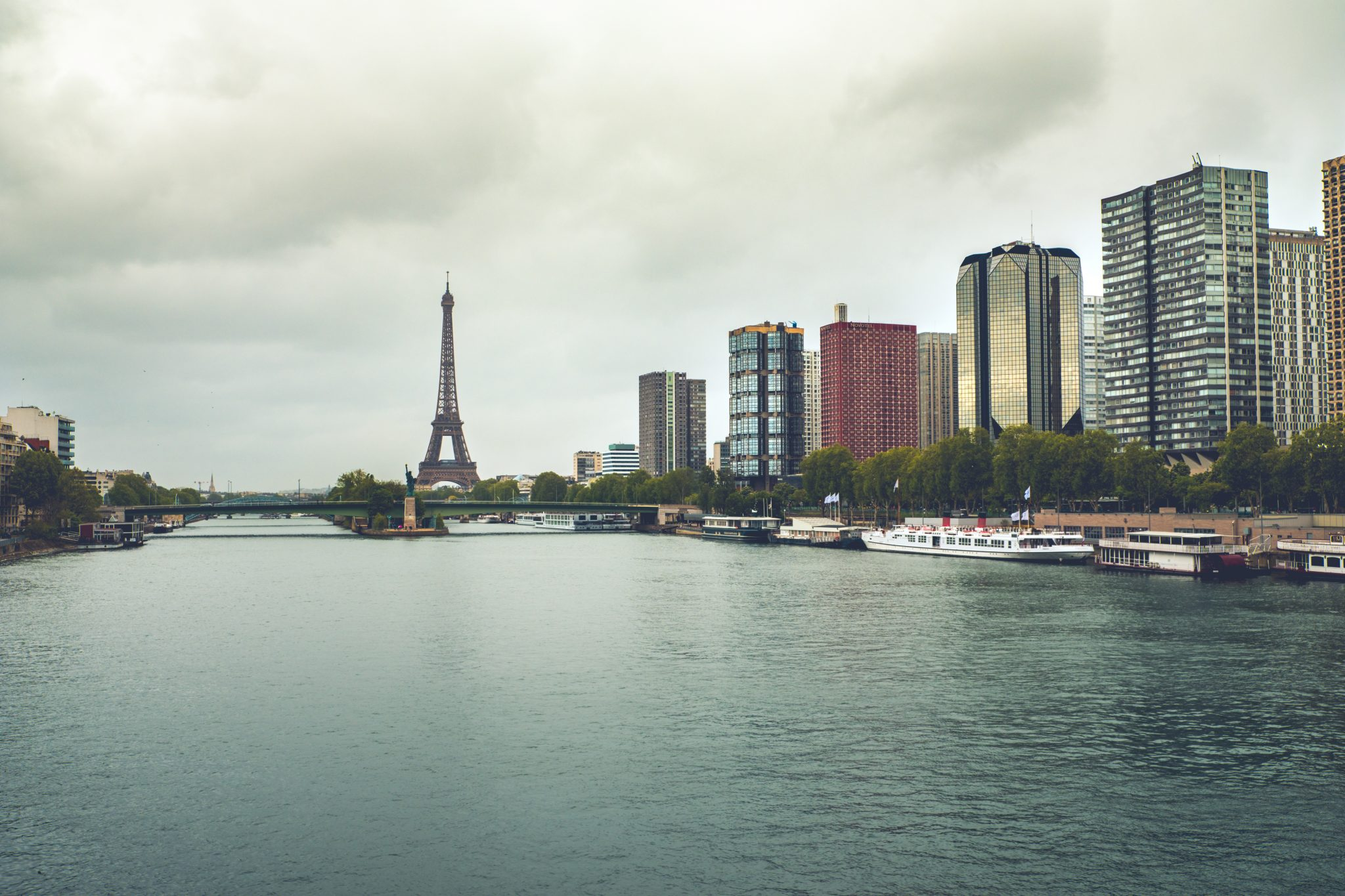 View of the seine, the statue of liberty and the eiffel tower photo by Jo Kassis