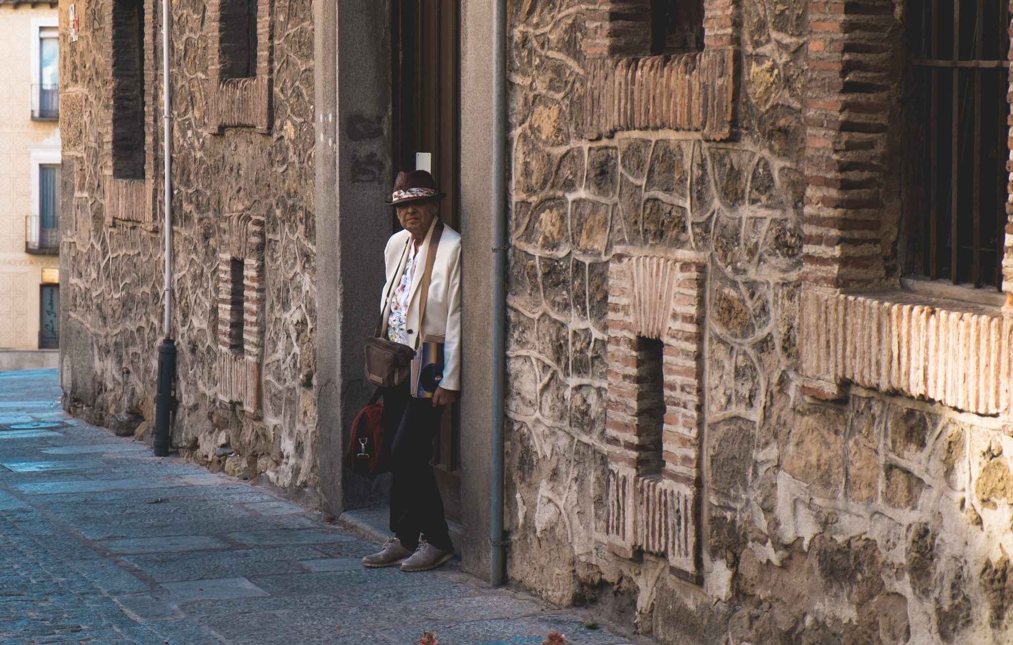 Old man standing in front of a door photo by Jo Kassis