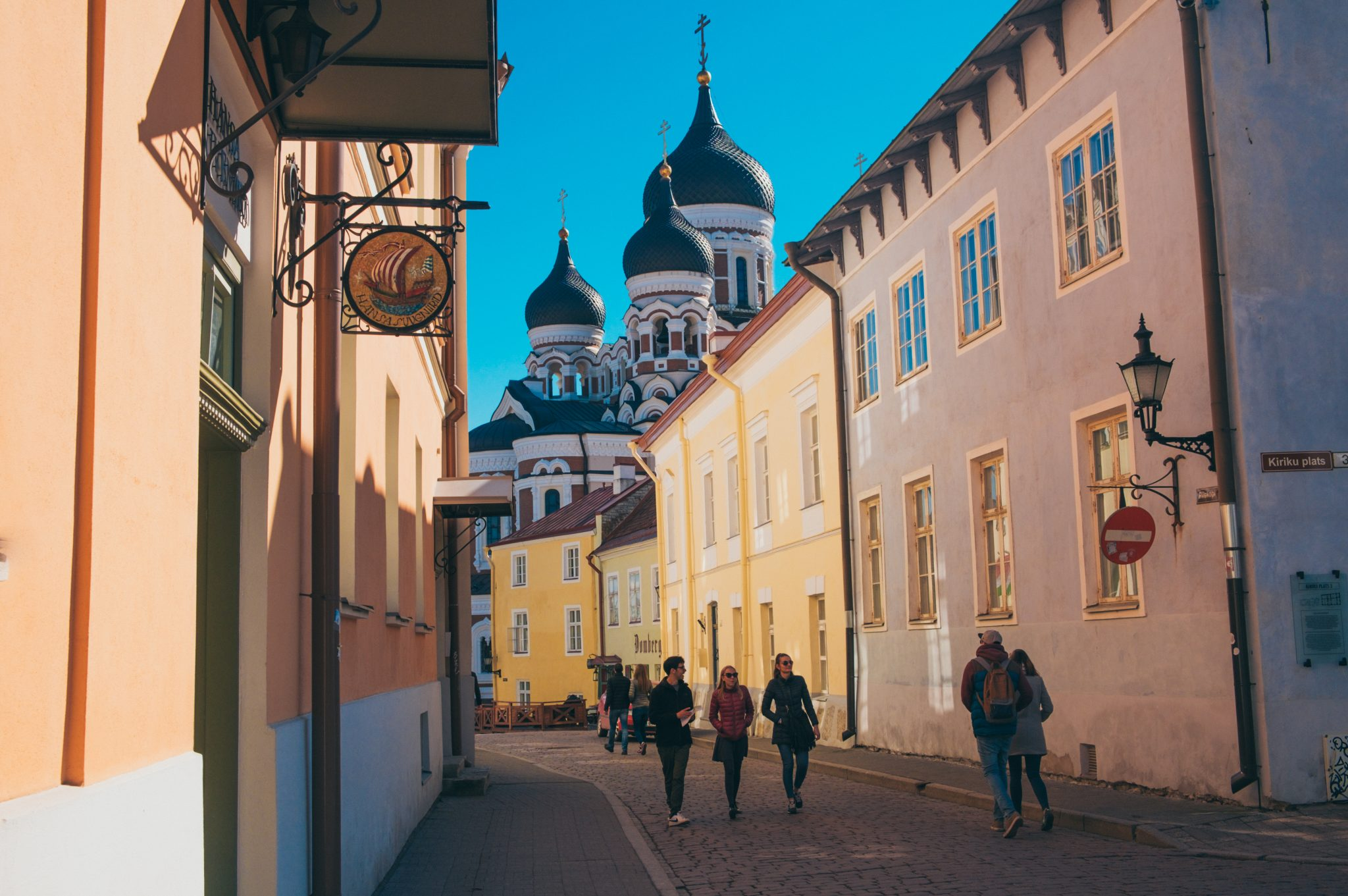 People walking in a street in Tallinn with the Alexander Nevsky Cathedral in the background photo by Jo Kassis