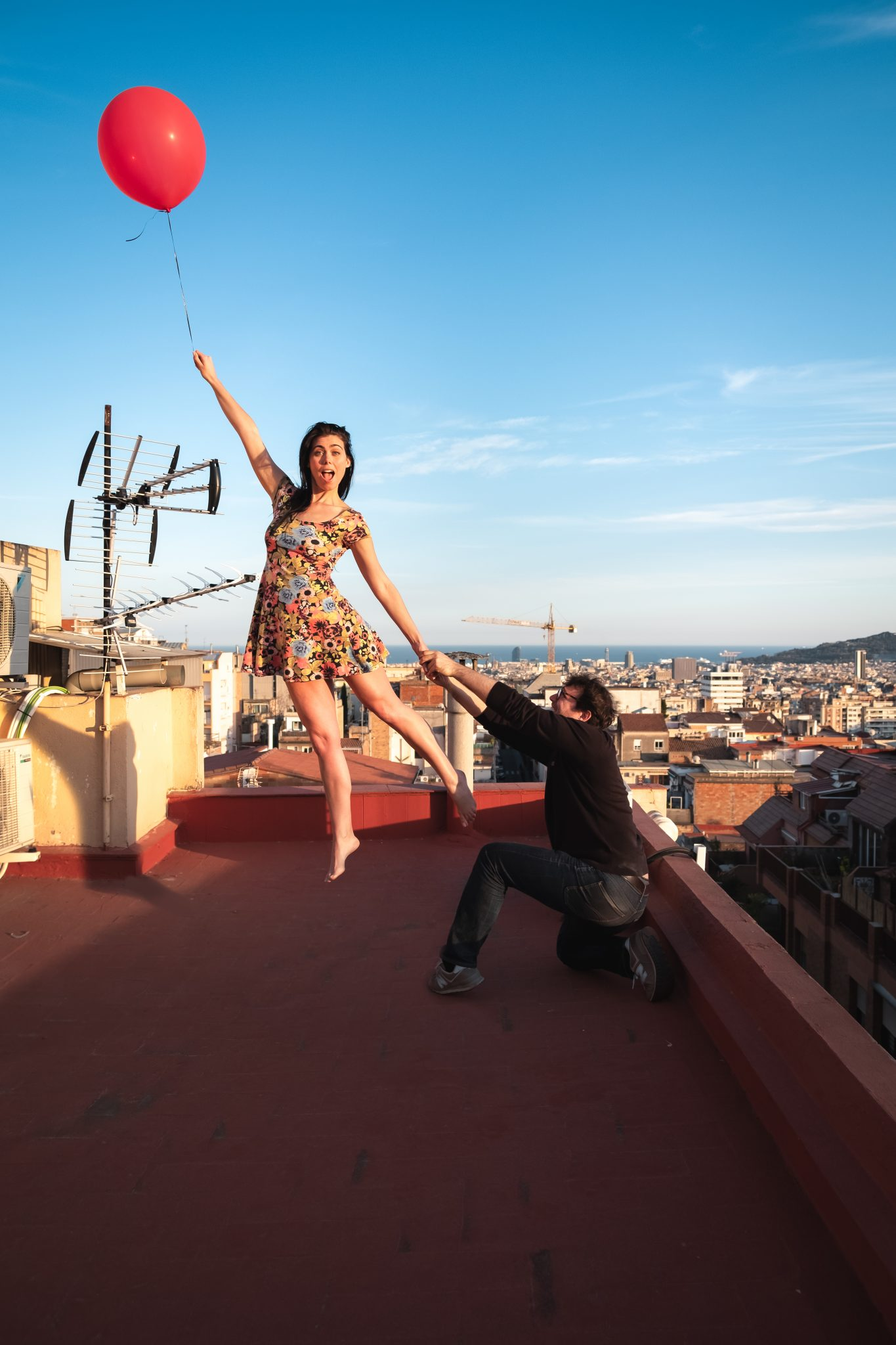 Lemonbahaya and Jo Kassis posing for creative levitation with red balloon over barcelona photo by Jo Kassis