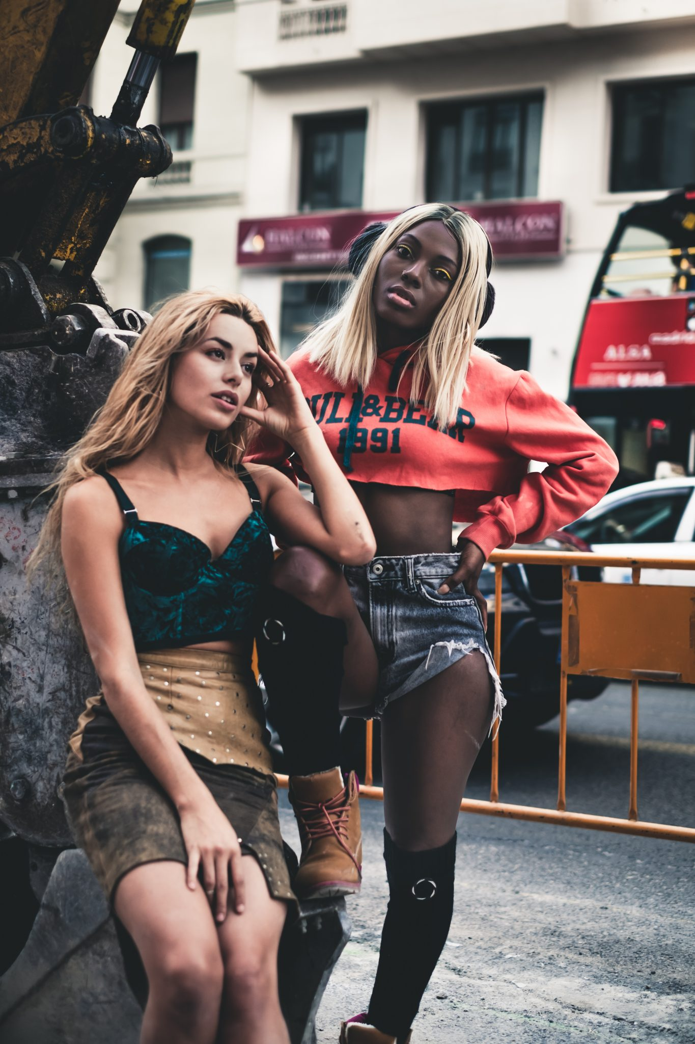 Two sexy female models posing on a truck photo by Jo Kassis
