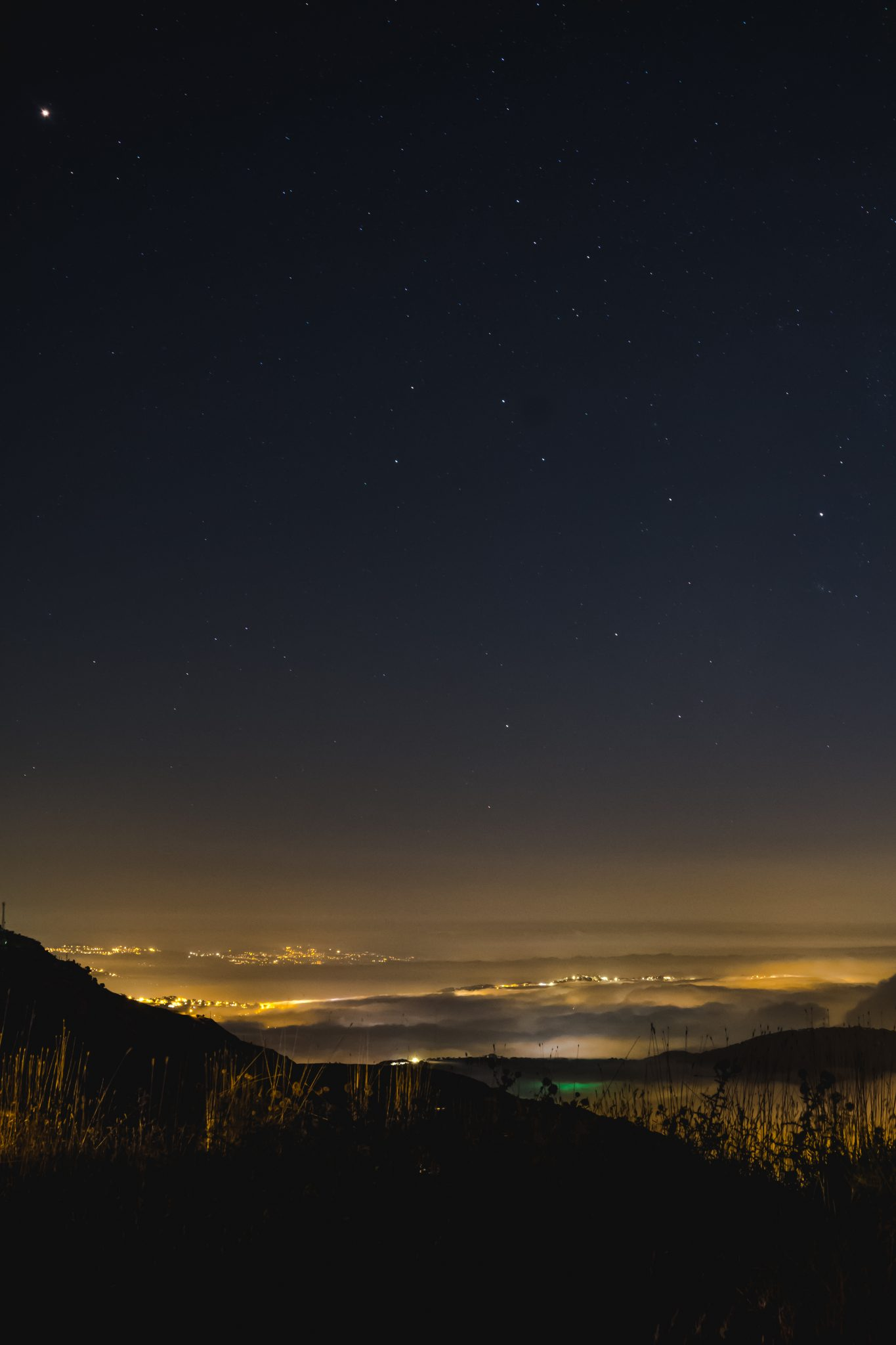 Panoramic view of the lebanese mountain at night from above the clouds photo by Jo Kassis