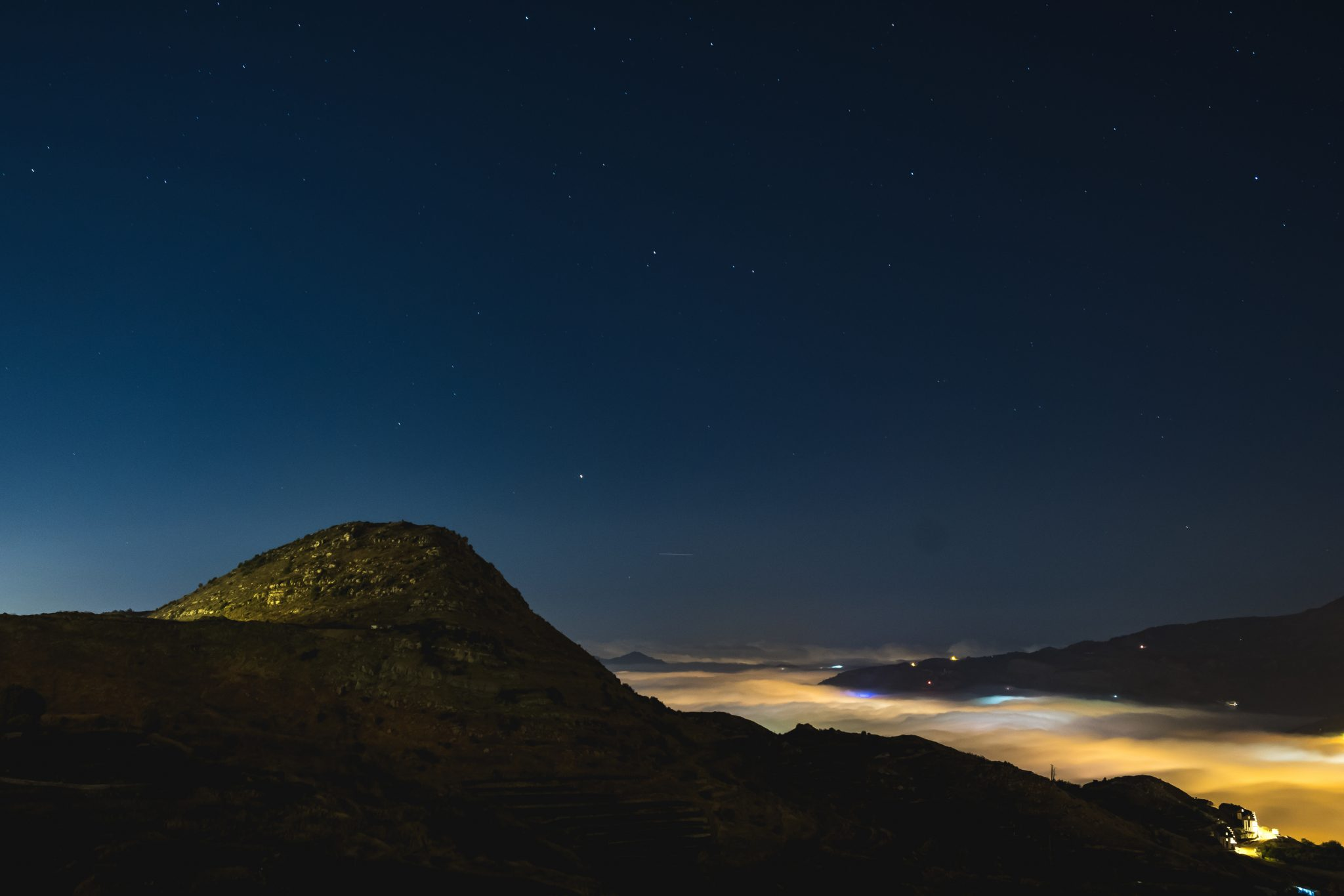 Panoramic view of the village of Faraya Hrajel in the lebanese mountain at night from above the clouds photo by Jo Kassis