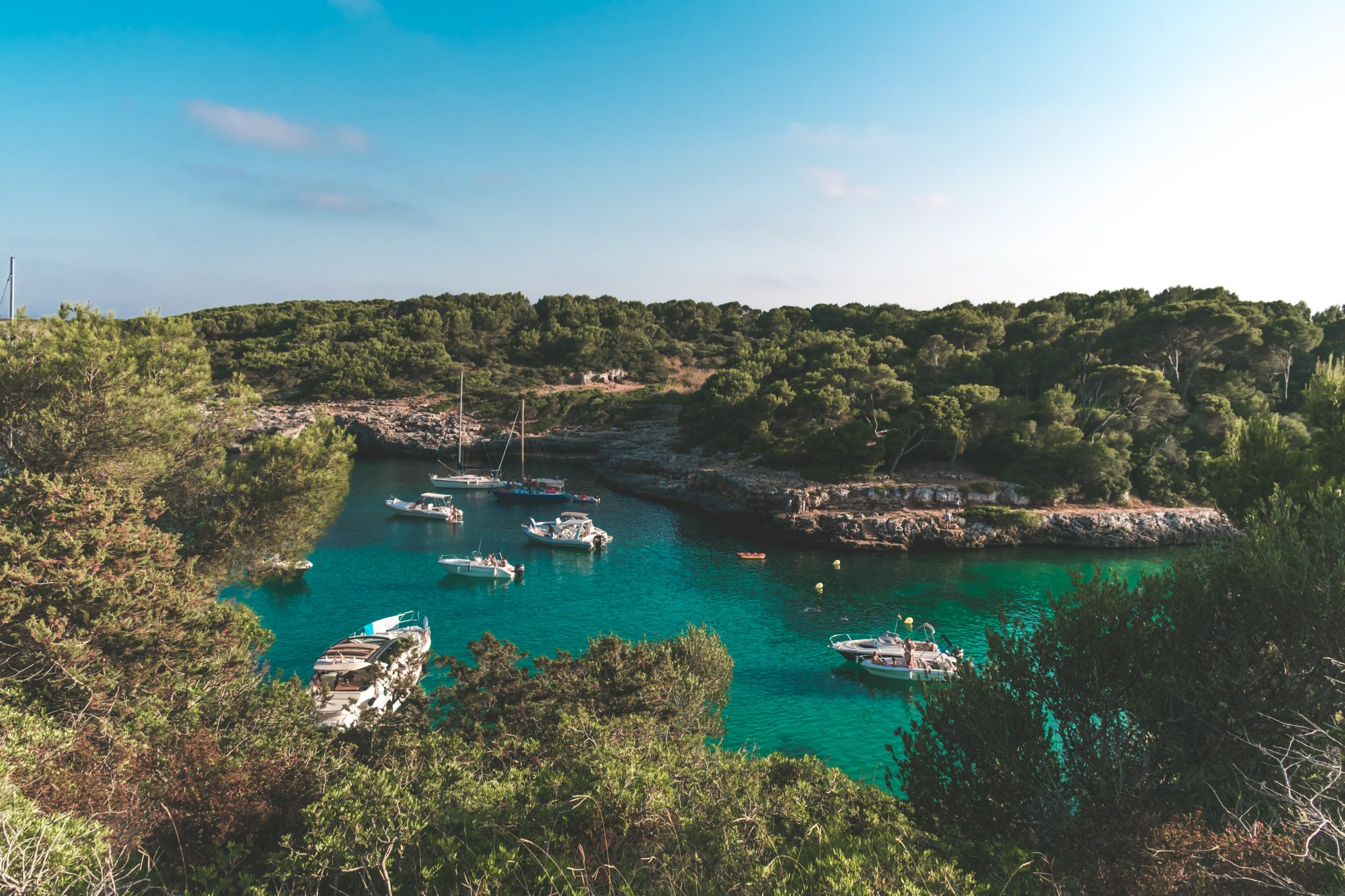 Boats in a blue lagoon photo by Jo Kassis