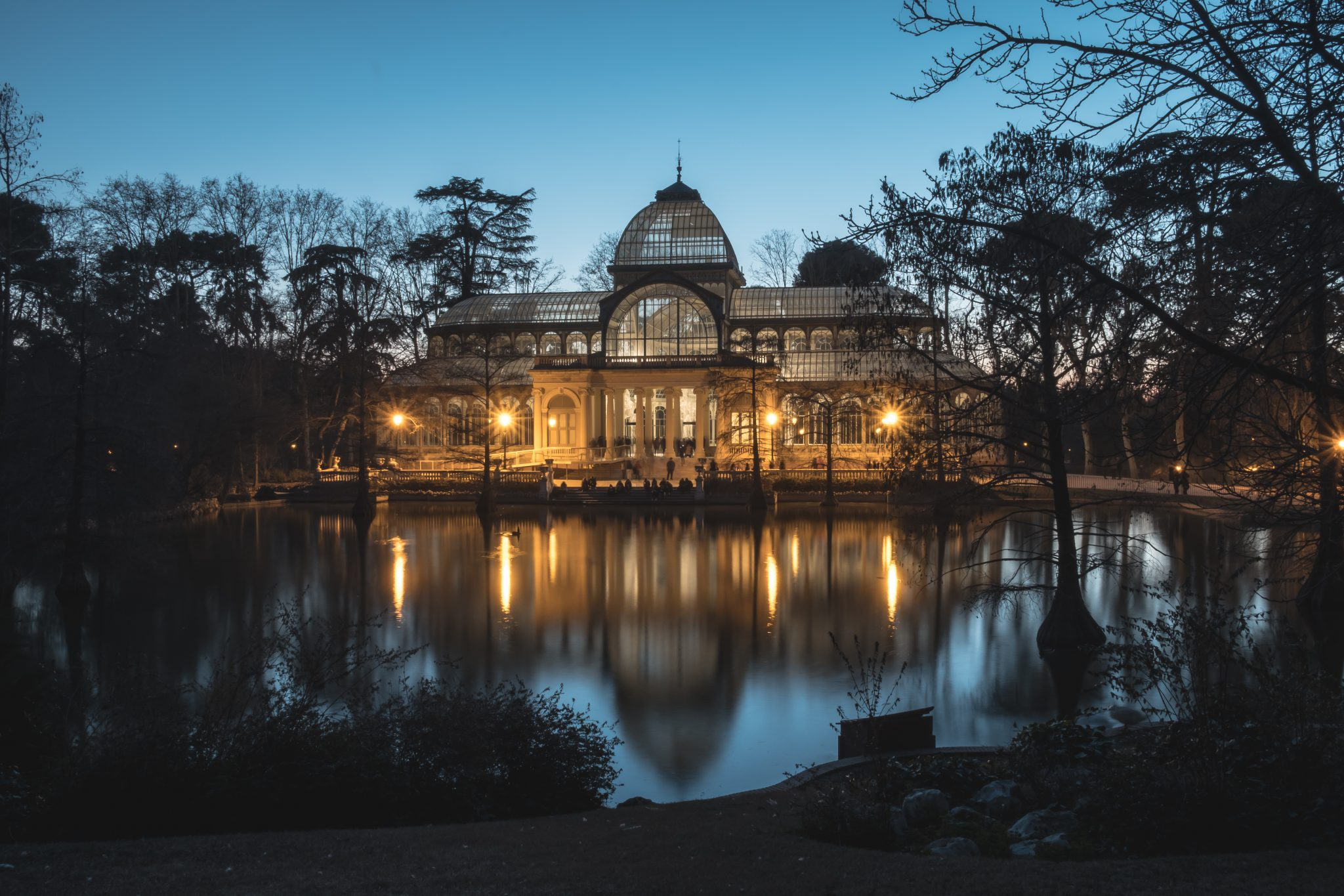 Palacio de Cristal in Retiro Park at night by Jo Kassis
