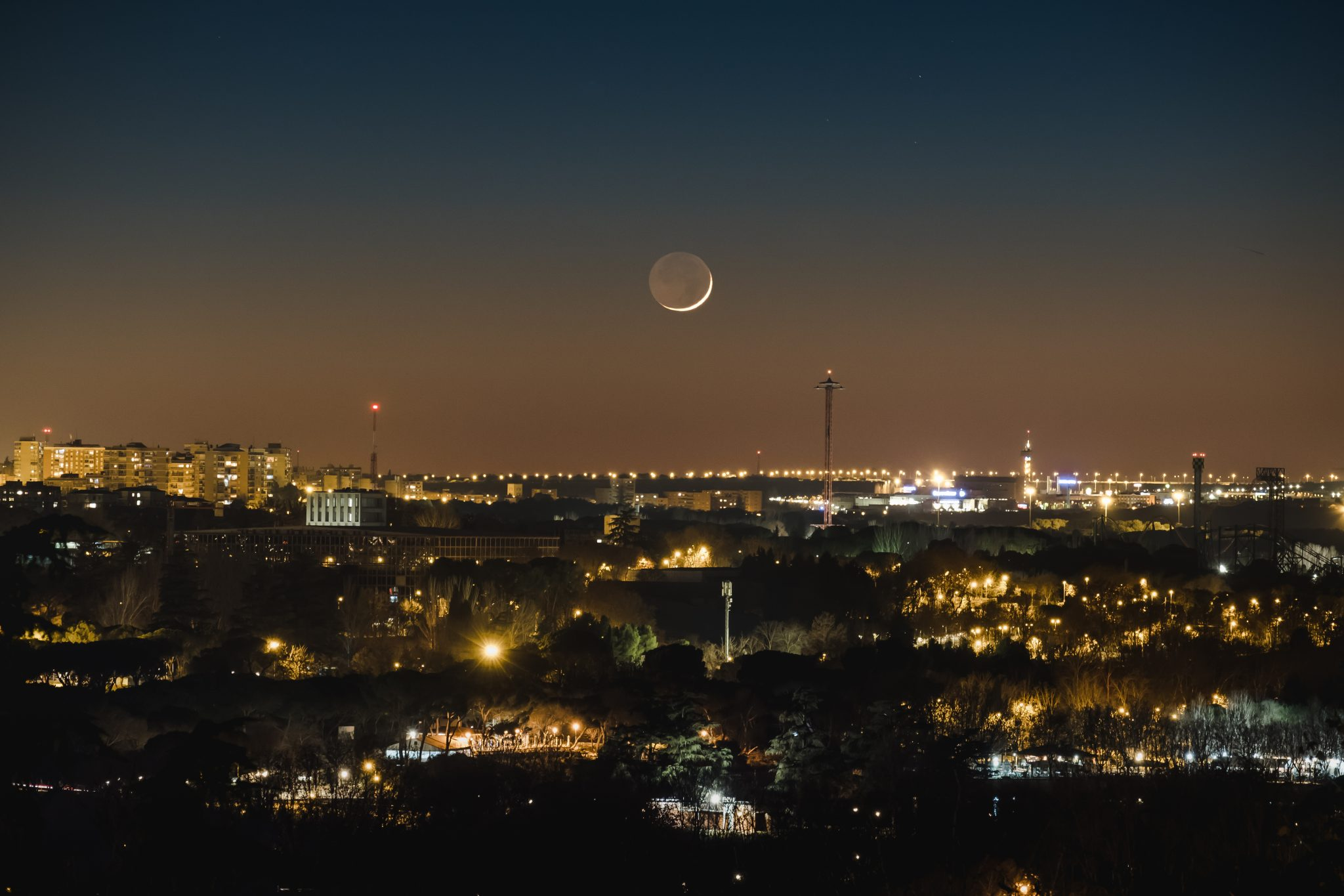 Madrid at night with the big moon shot photo by Jo Kassis