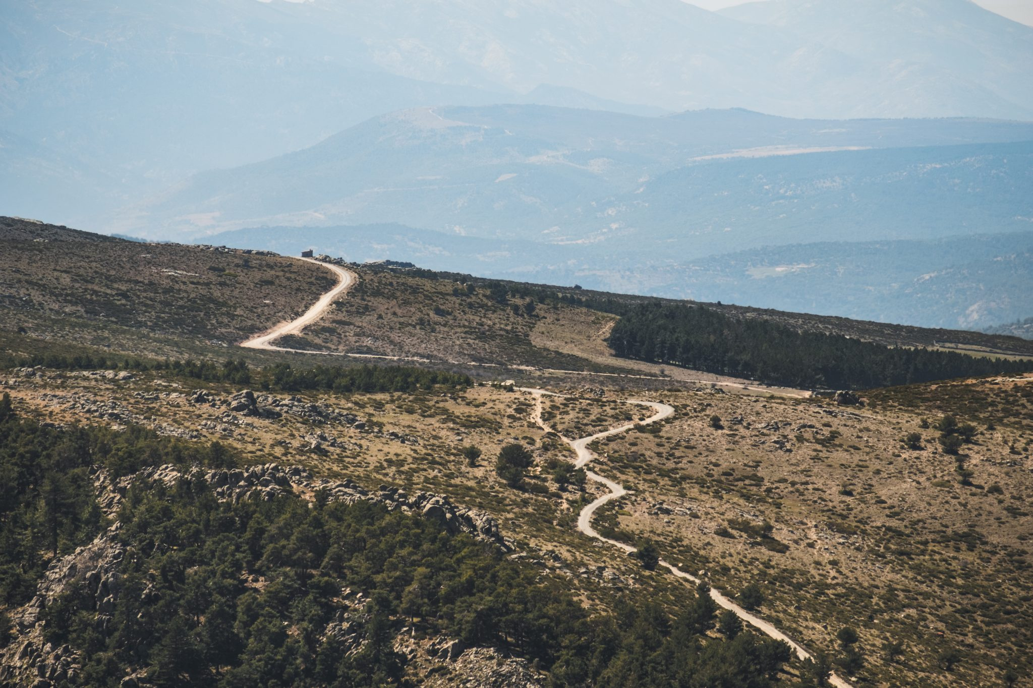 A path between the mountains photo by Jo Kassis