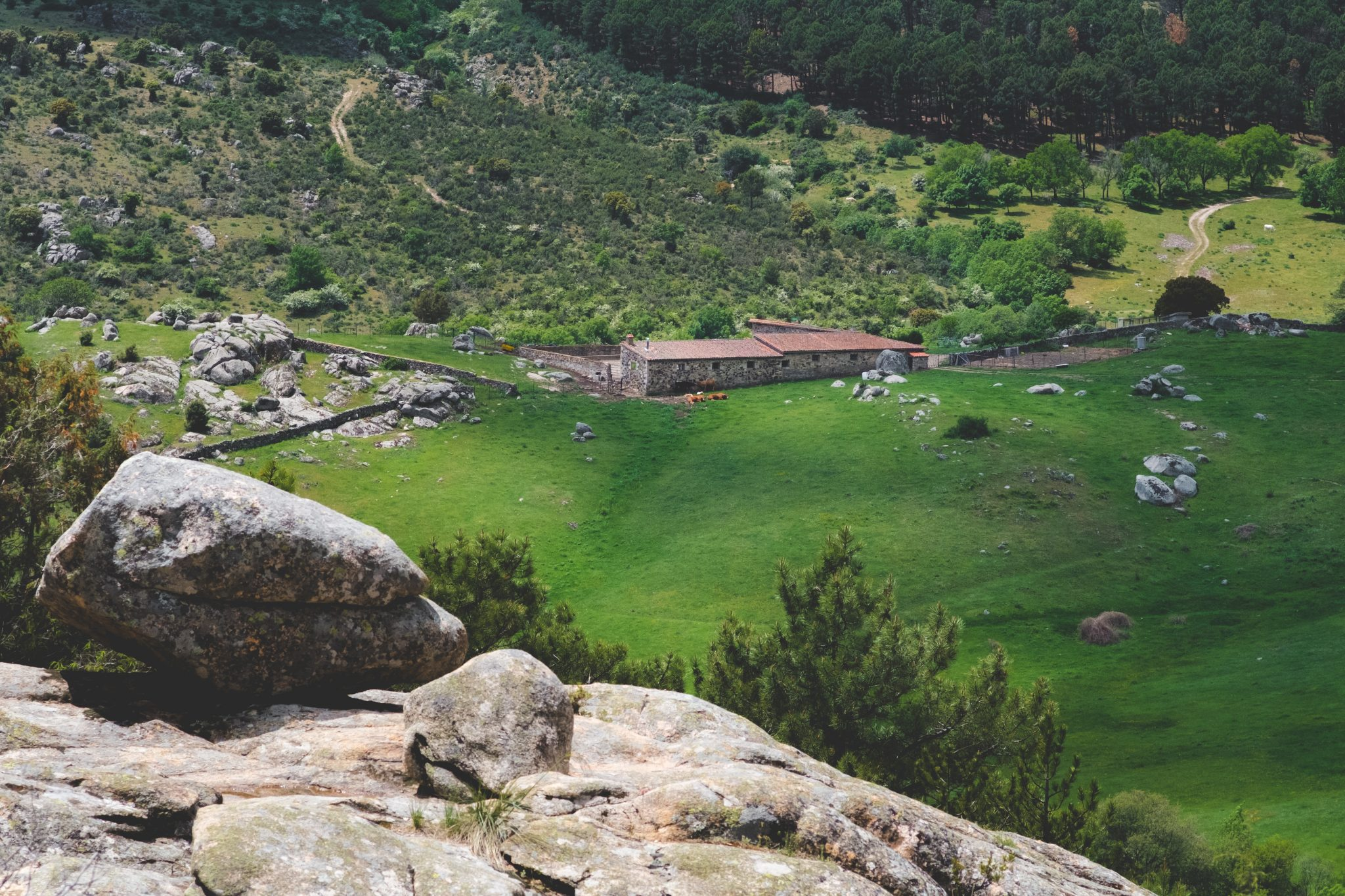 Panoramic view of the mountains with a countryside house in cercedilla by Jo Kassis