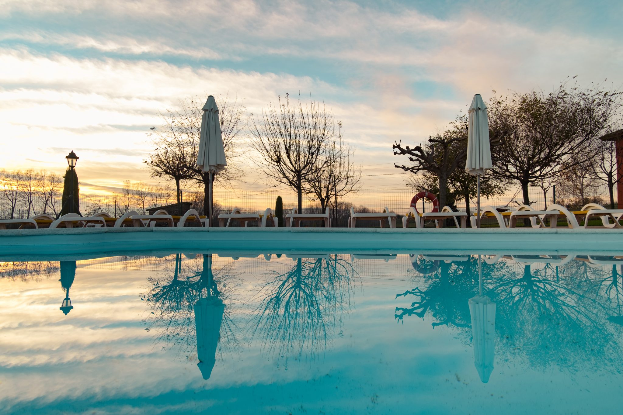 View of a pool at sunset photo by Jo Kassis