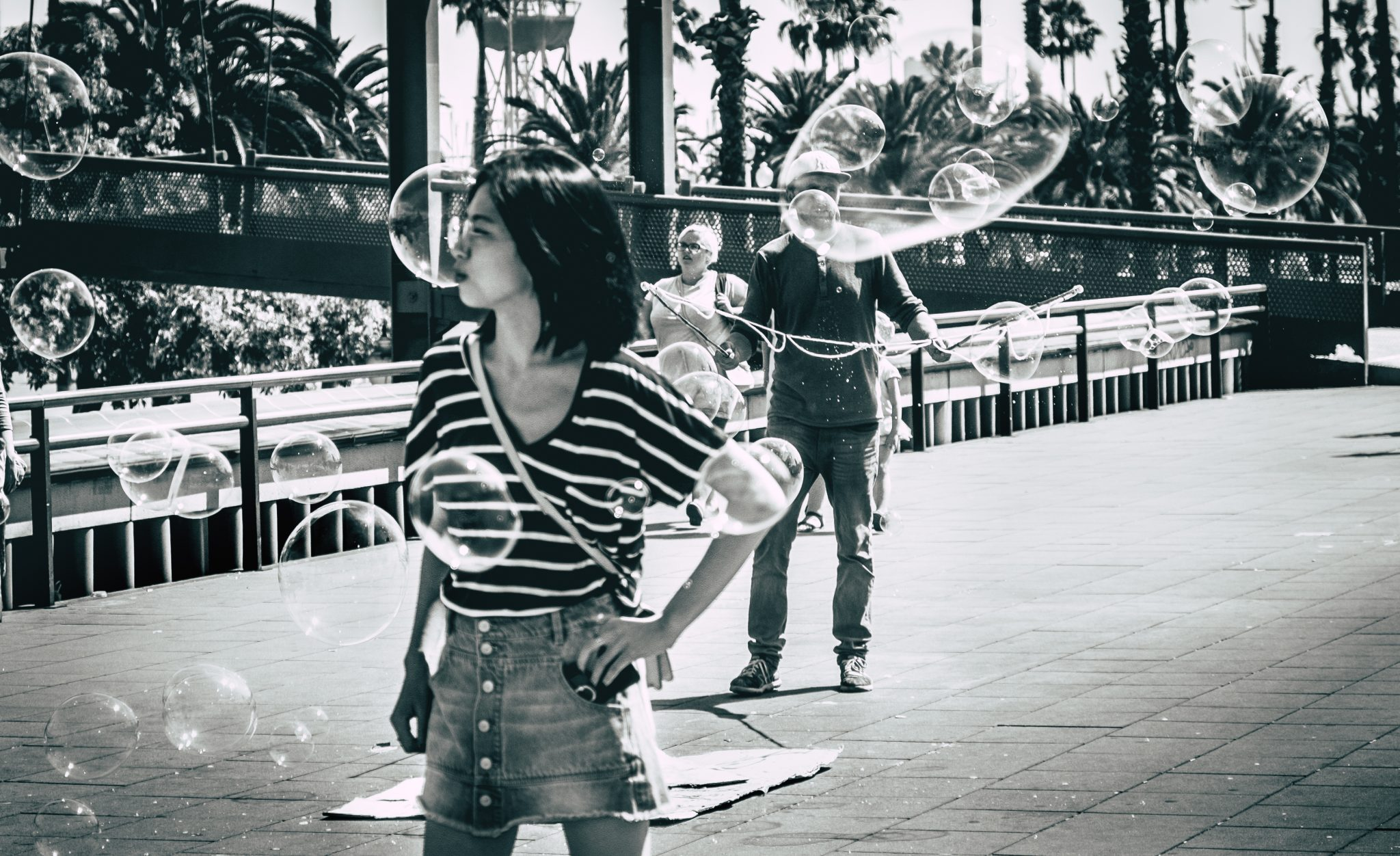 Women posing on the street in Barcelona surrounded by bubbles photo by Jo Kassis