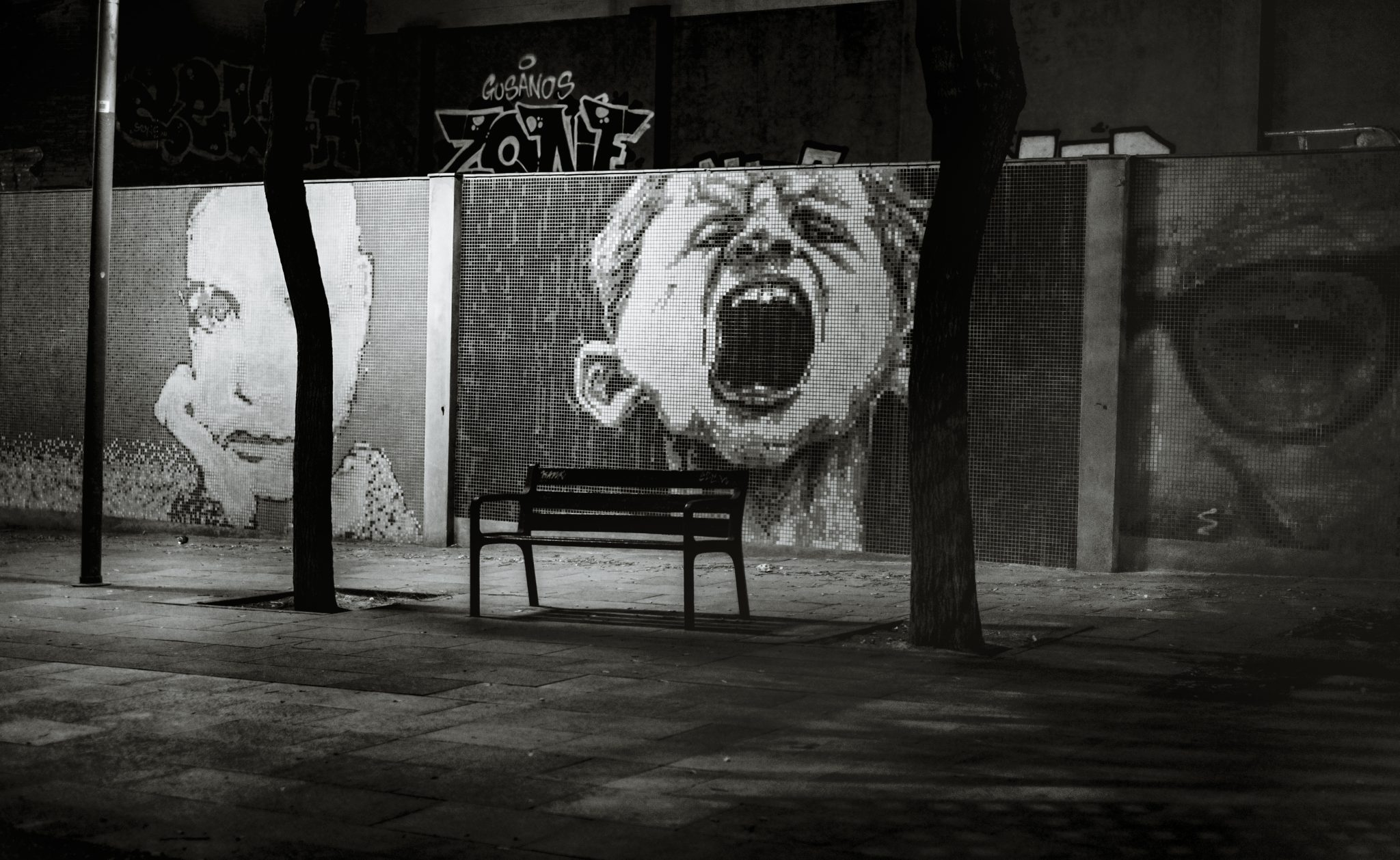 Mural of a child shouting in a park in the city of Barcelona photo by Jo Kassis