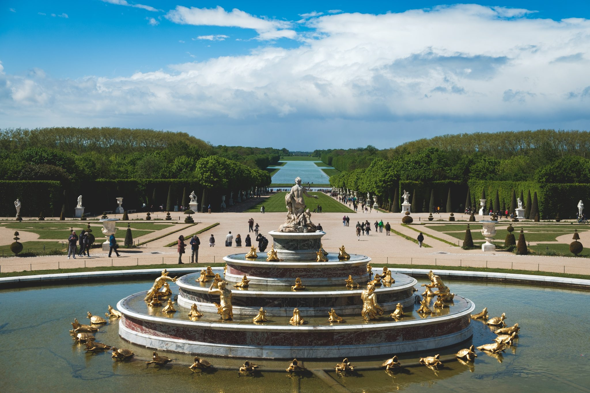 Fountain in the garden of the chateau de versailles photo by Jo Kassis