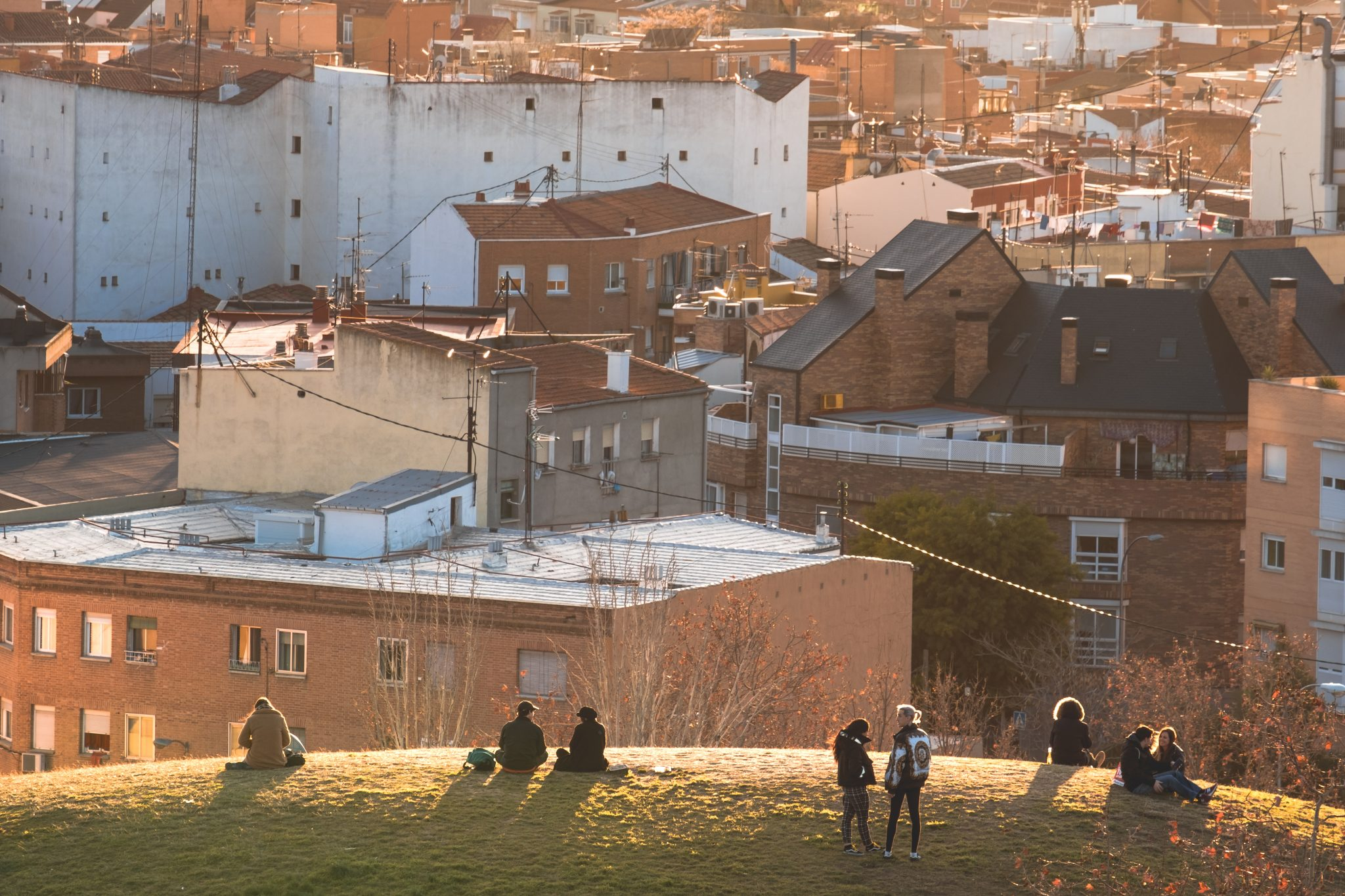 Friends watching the sunset in the parque de las siete tetas with the city of Madrid in the background photo by Jo Kassisphoto by Jo Kassis