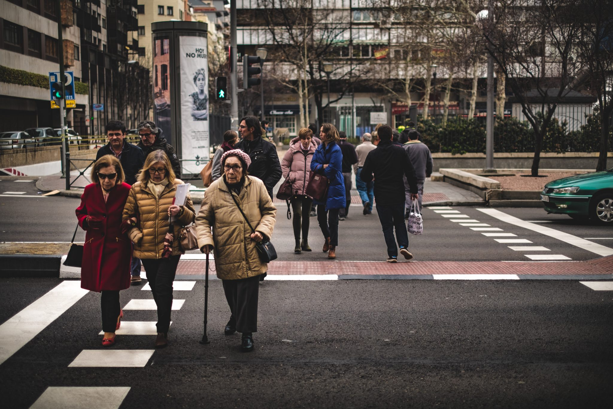 Three old ladies crossing the street in Madrid winter photo by Jo Kassis