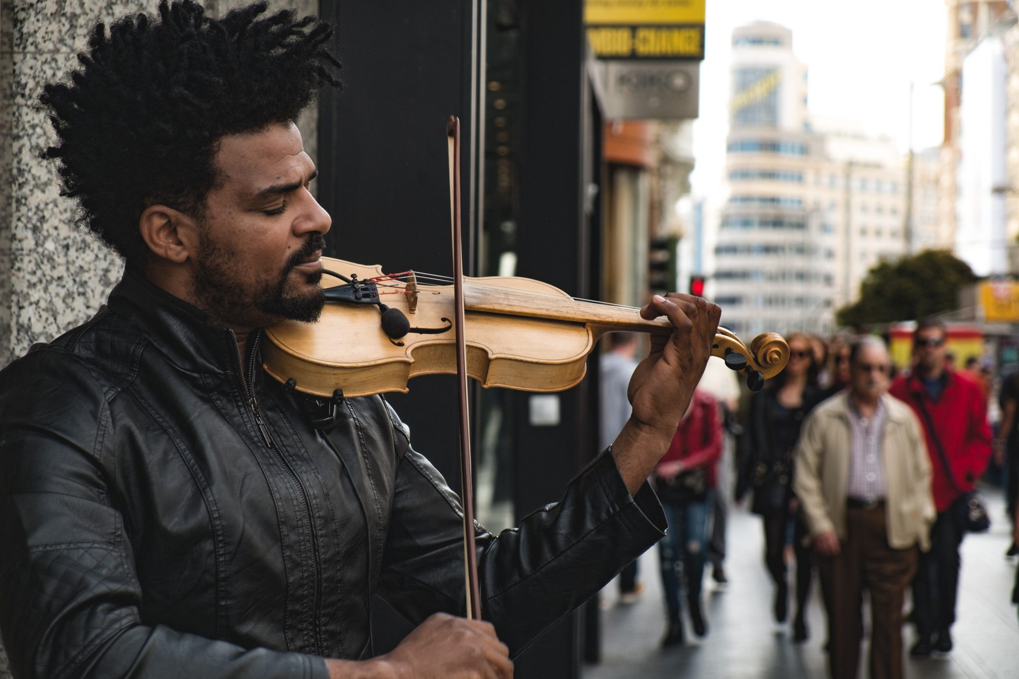 Men playing the violin on Gran via in Madrid photo by Jo Kassis