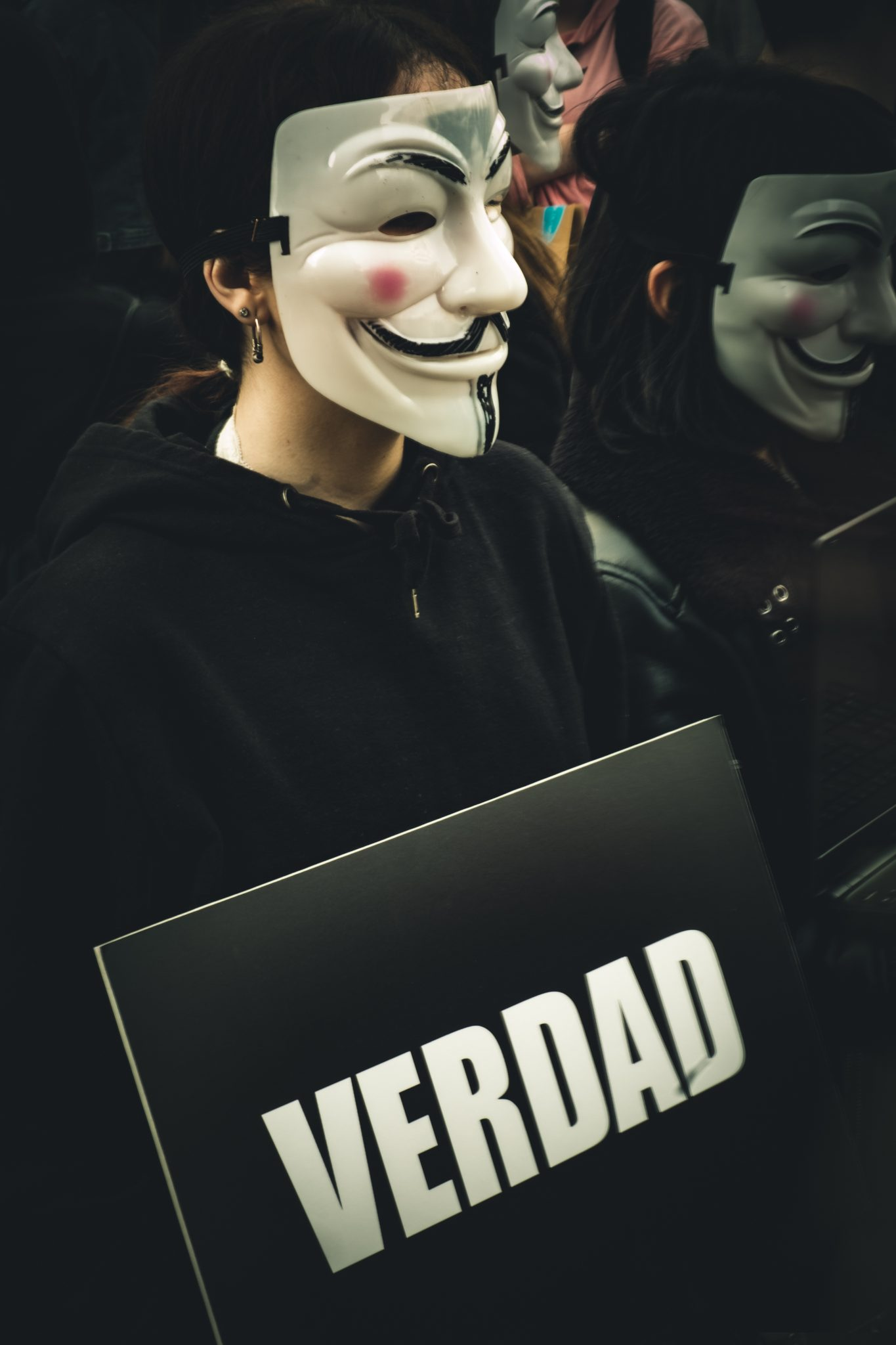 Men wearing the anonymous mask protesting in madrid photo by Jo Kassis