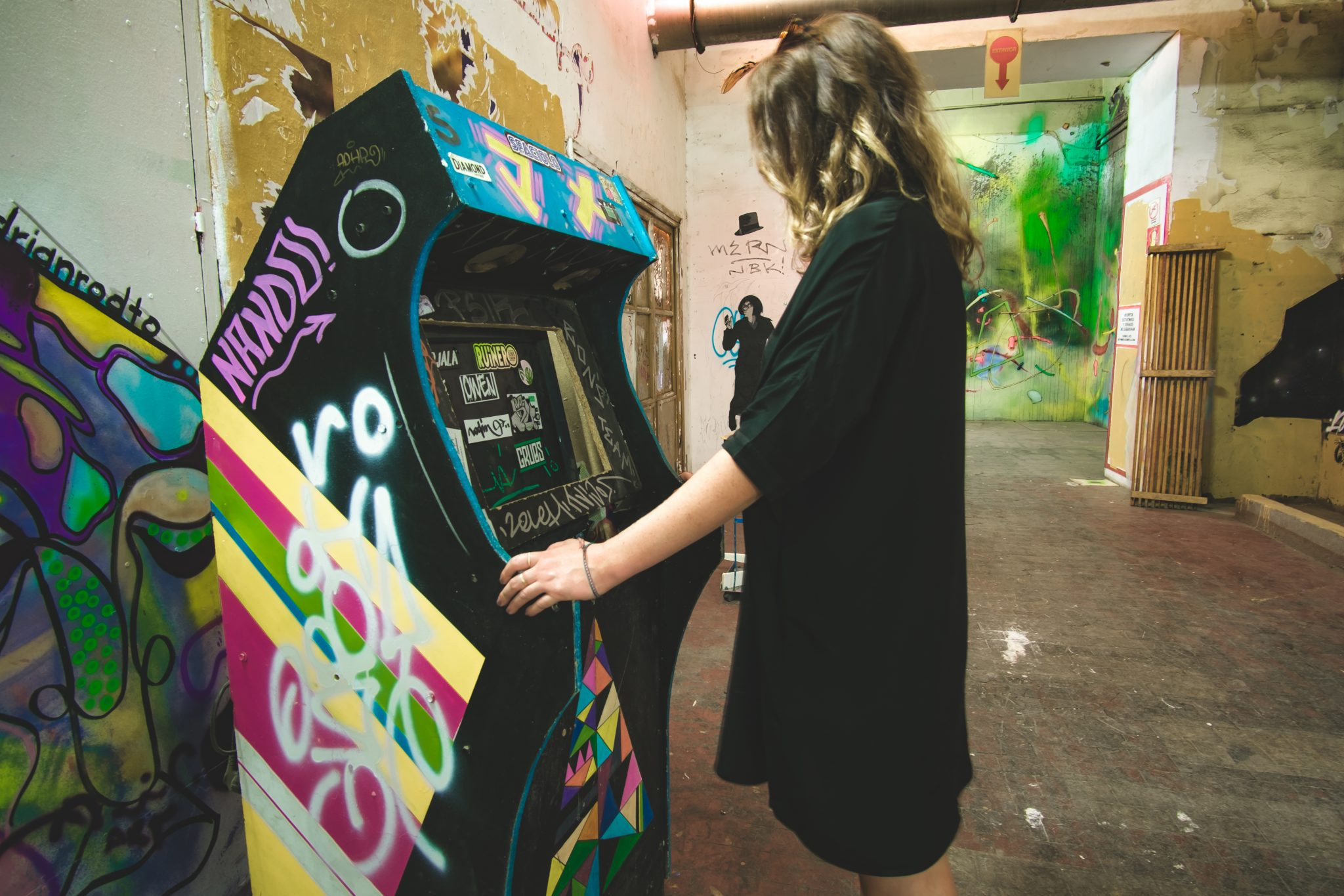 Girl playing arcade game in the tabacalera of madrid photo by Jo Kassis