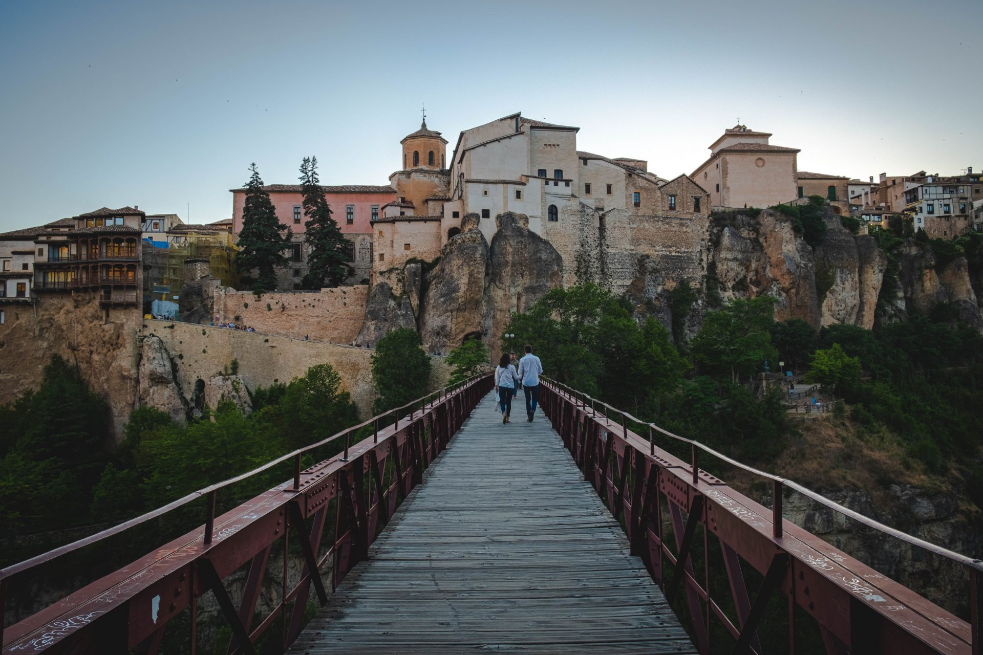 Couple walking on the puente de san pablo bridge towards the village of Cuenca photo by Jo Kassis