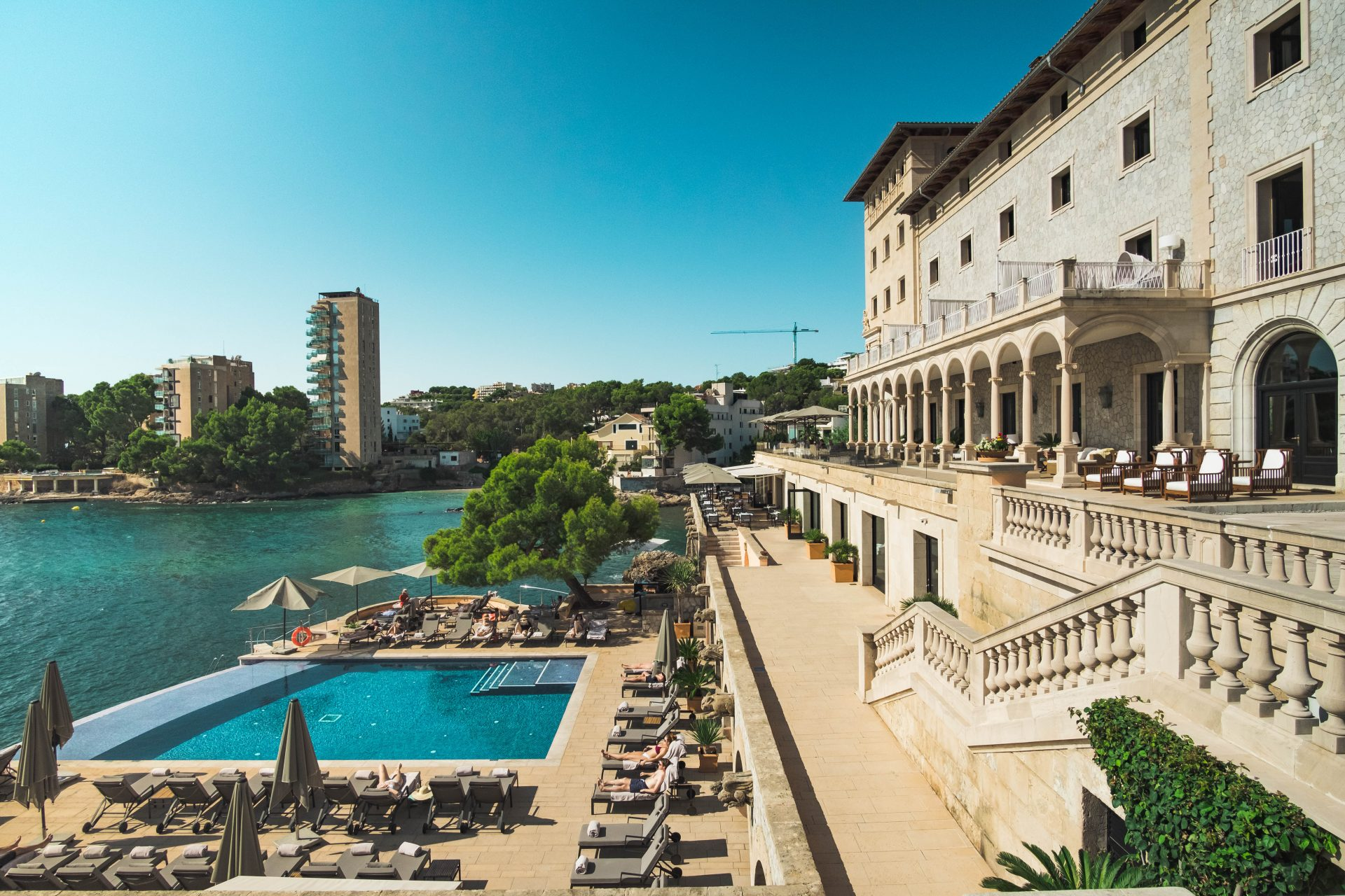 Pool and Facade of the Hospes Hotel Maricel Mallorca overlooking the sea photo by Jo Kassis