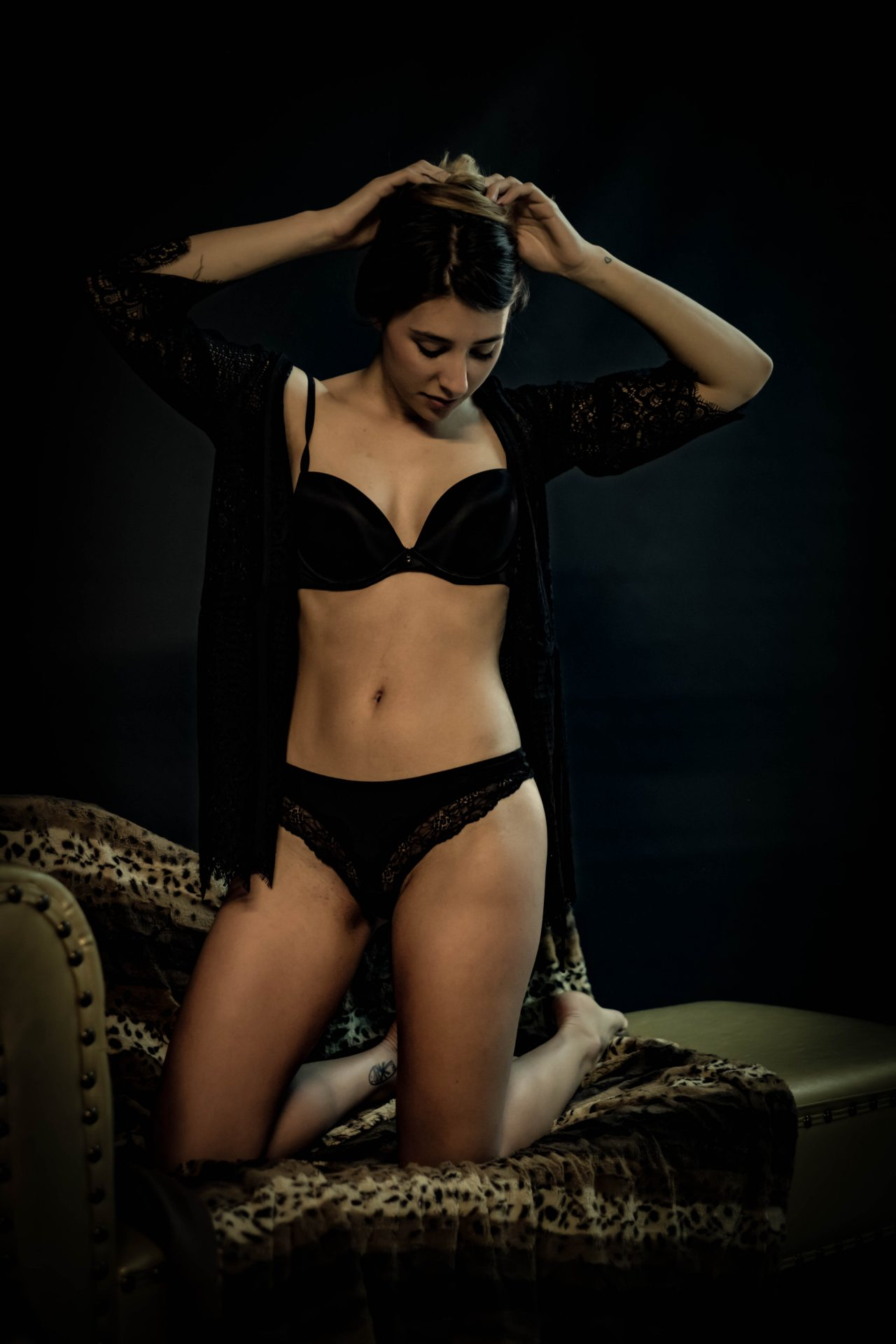 Female model posing in underwear for a boudoir session photo by Jo Kassis