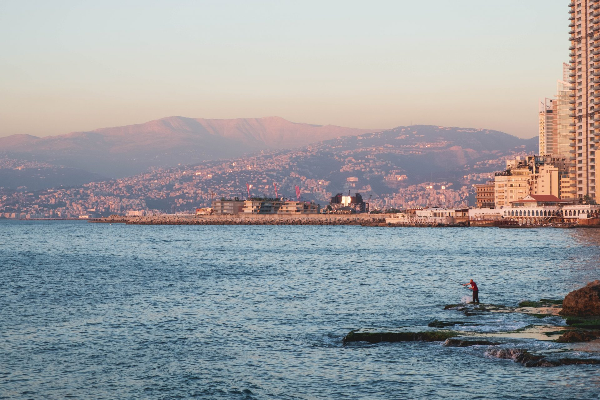 Fisherman in Beirut waterfront area near Raouche photo by Jo Kassis