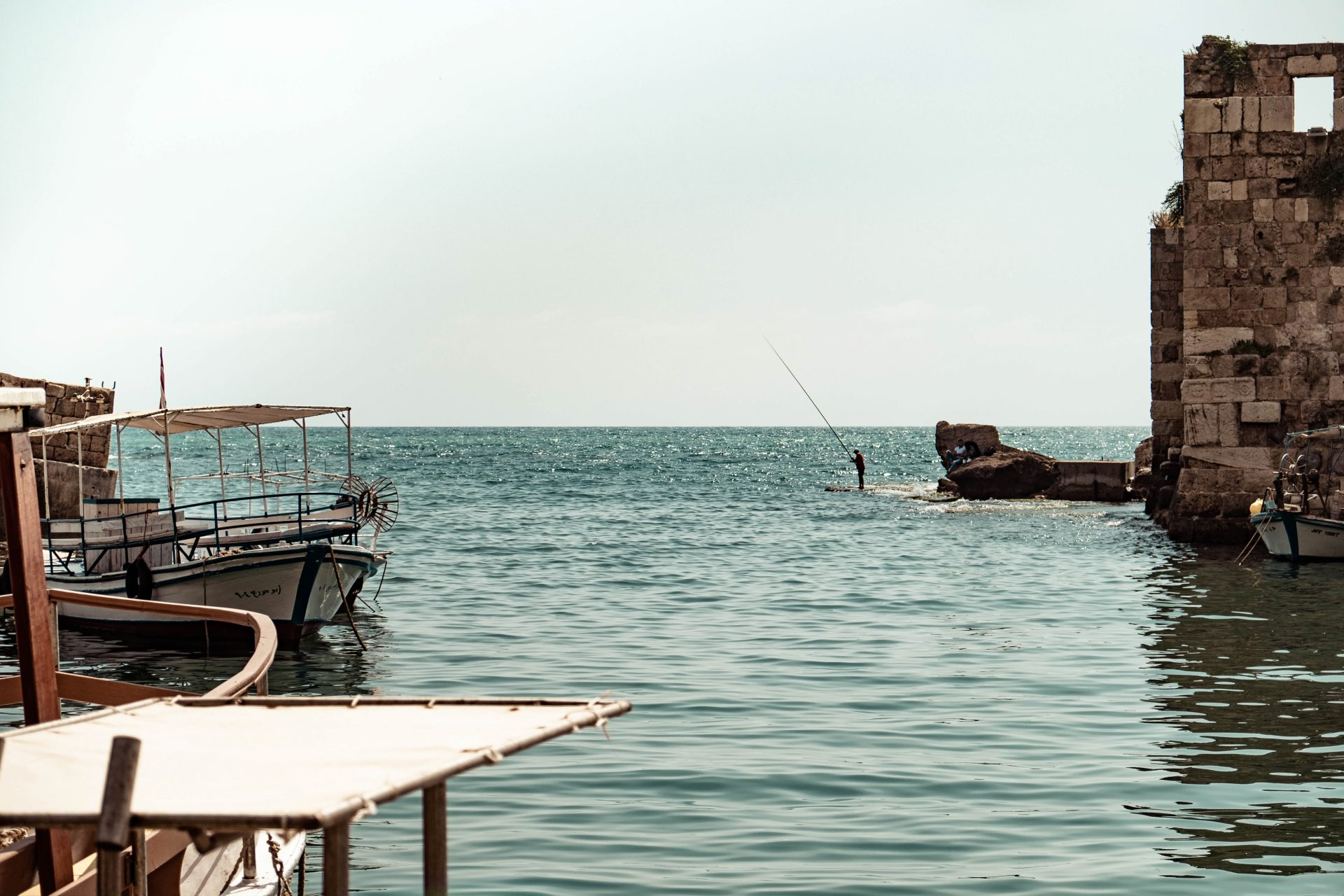 Fisherman fishing in the harbor of Byblos photo by Jo Kassis