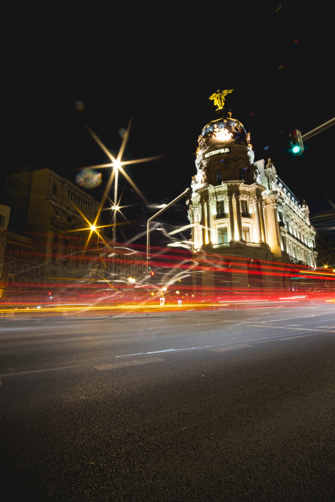 Metropolis building Madrid at night long exposure shot photo by Jo Kassis
