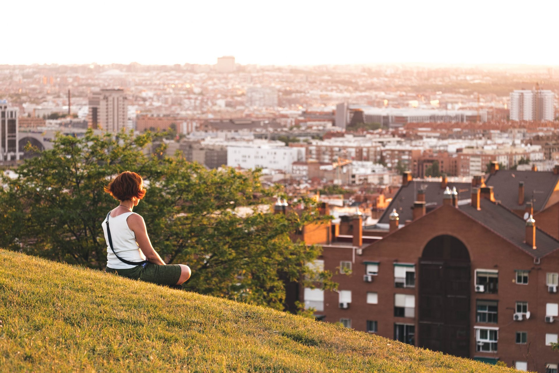 Women meditating in the parque de las siete tetas with the city of Madrid in the background photo by Jo Kassis