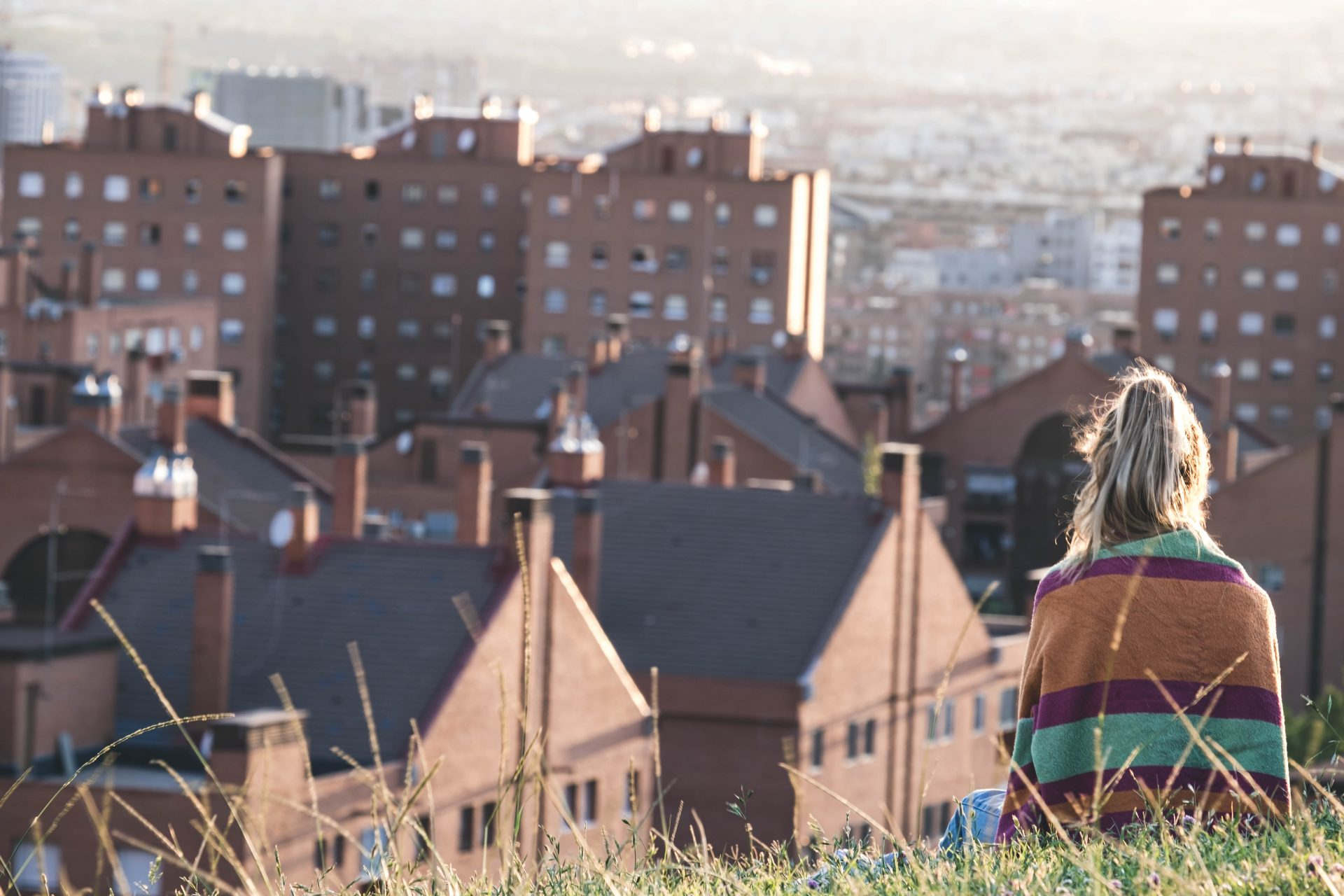 Blond girl staring at the city of Madrid in the parque de las siete tetas photo by Jo Kassis