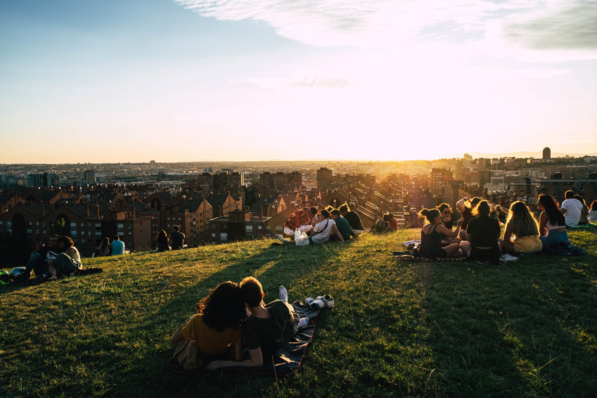 Friends picnic at sunset in the parque de las siete tetas with the city of Madrid in the background photo by Jo Kassisphoto by Jo Kassis