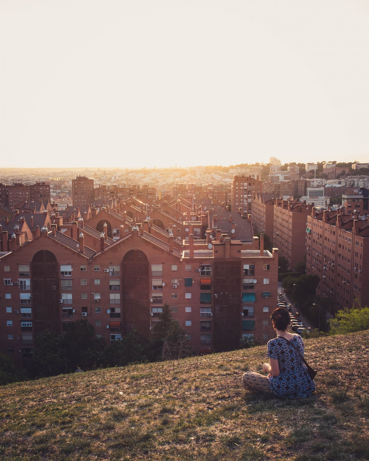 Women watching the sunset in the parque de las siete tetas with the city of Madrid in the background photo by Jo Kassisphoto by Jo Kassis