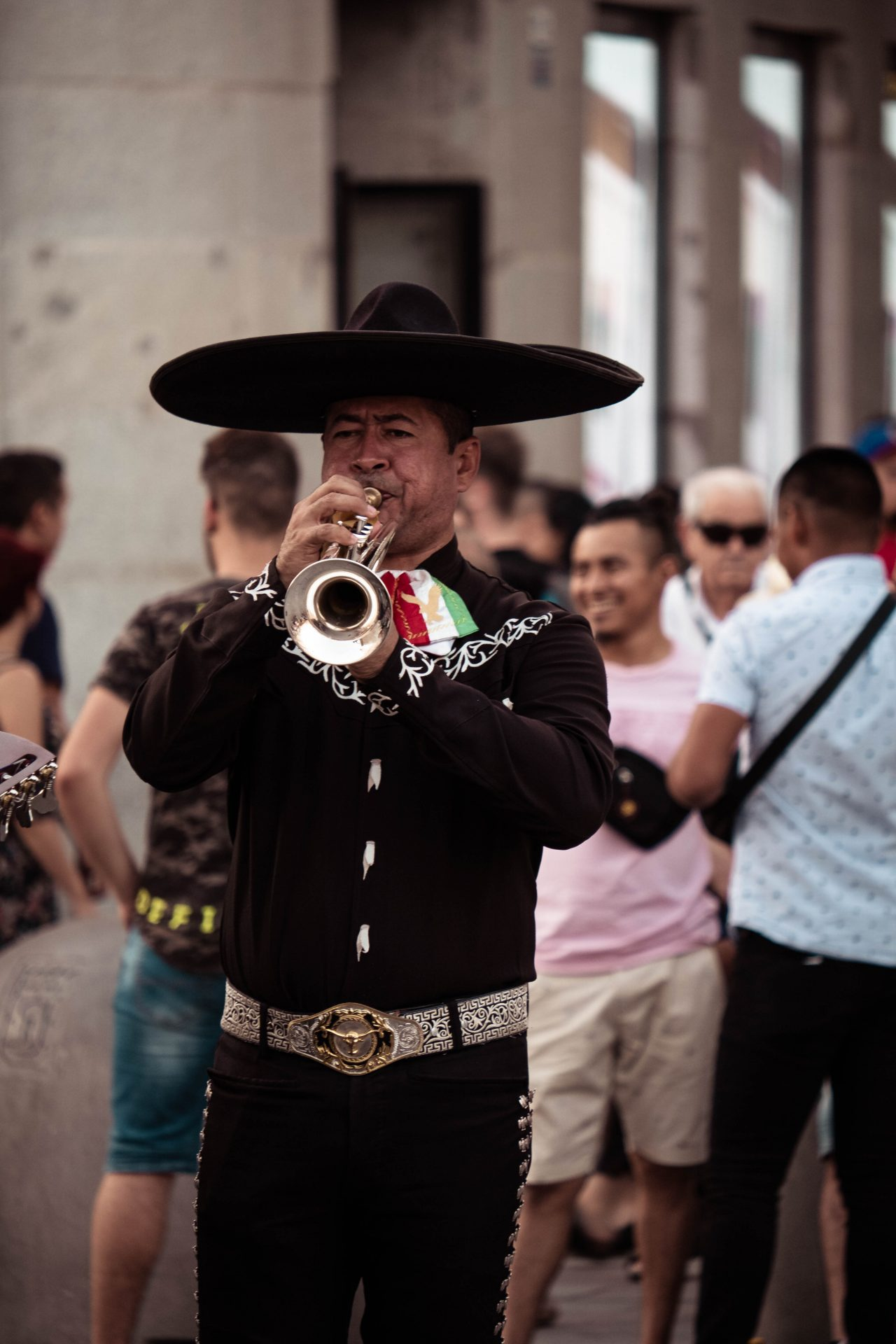 Men dressed in a mexican outfit playing trumpet in the streets of Madrid photo by Jo Kassis