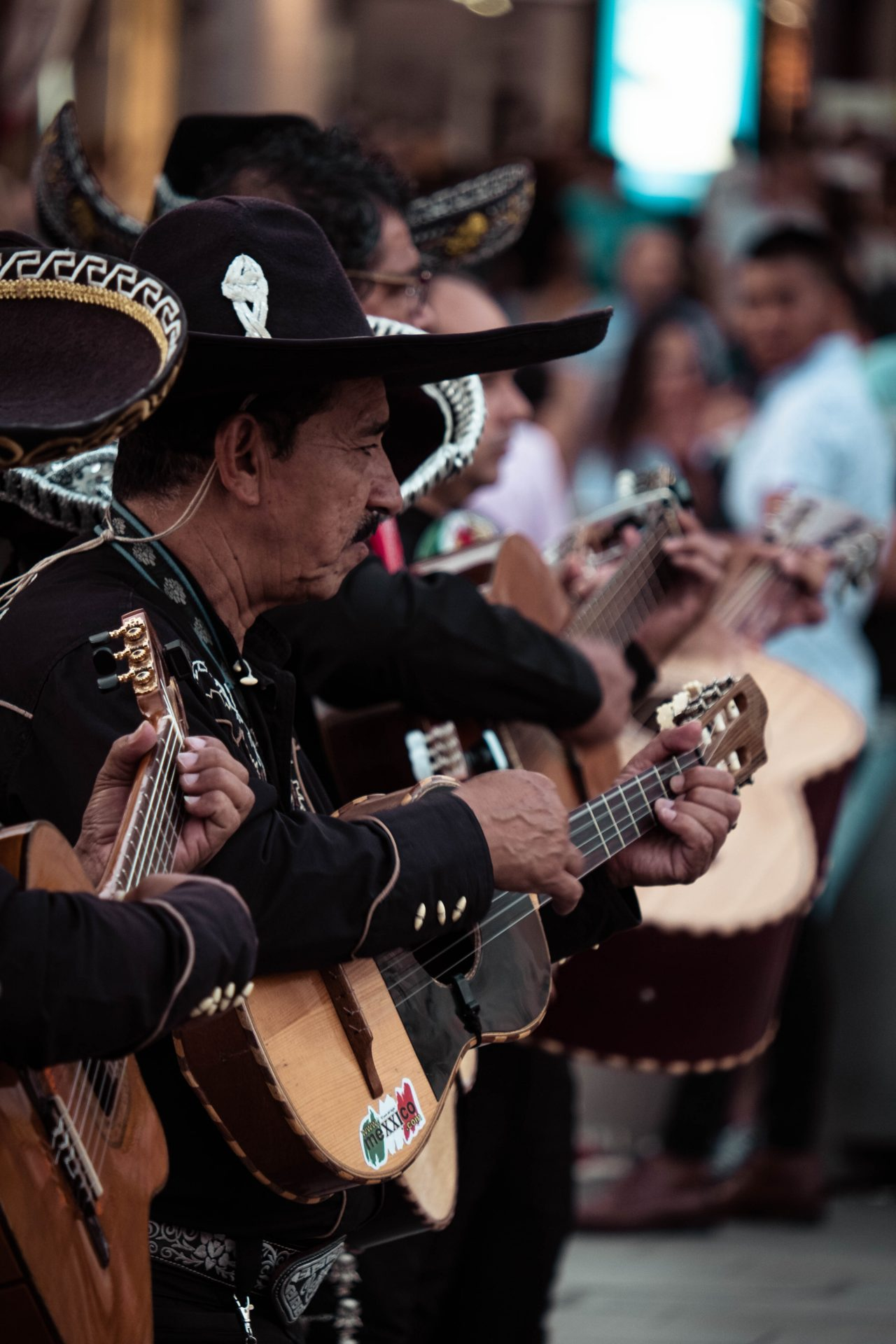 Band dressed in a mexican outfit playing guitar in the streets of Madrid photo by Jo Kassis