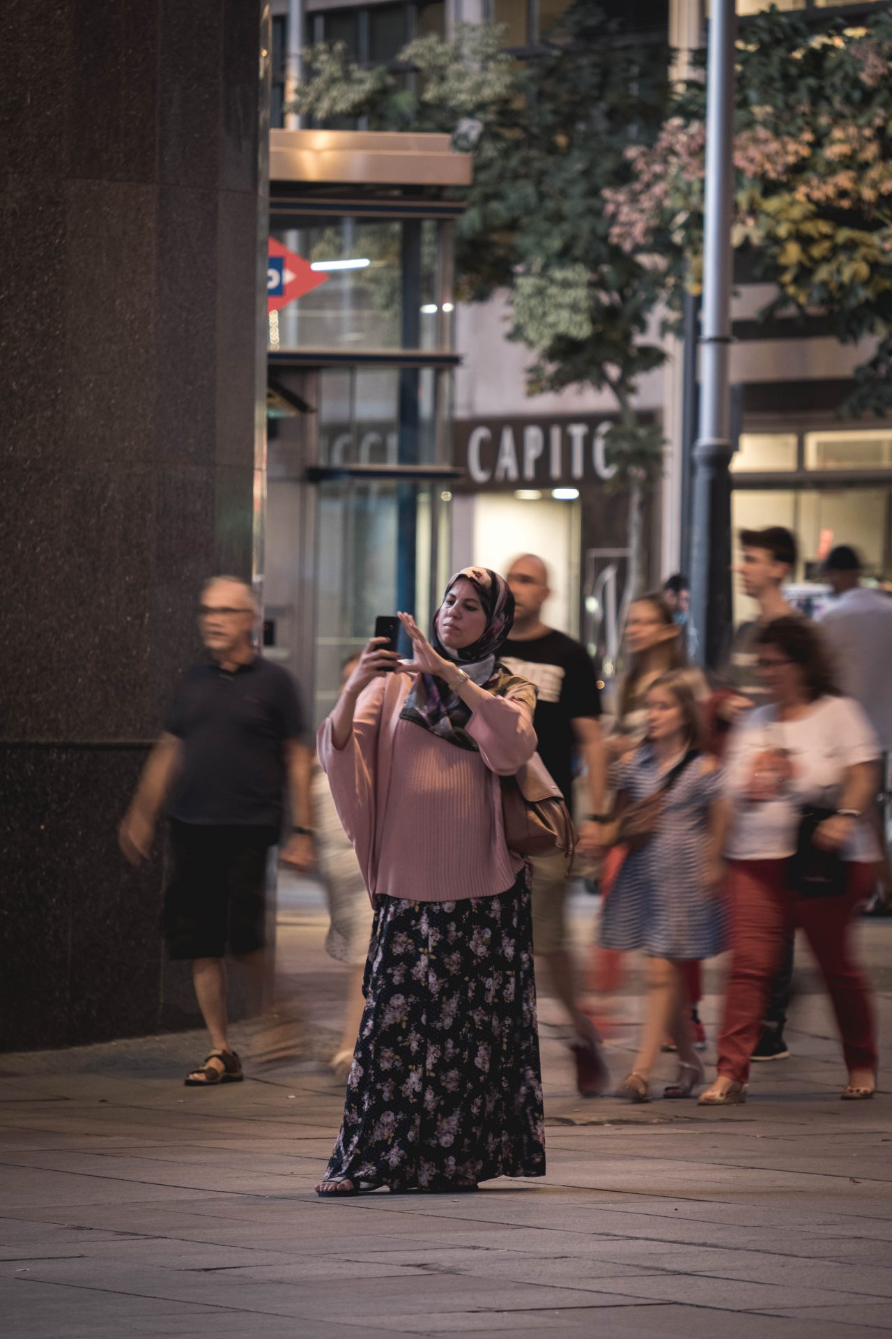 Muslim women taking a photo in the streets of madrid near Callao photo by Jo Kassis