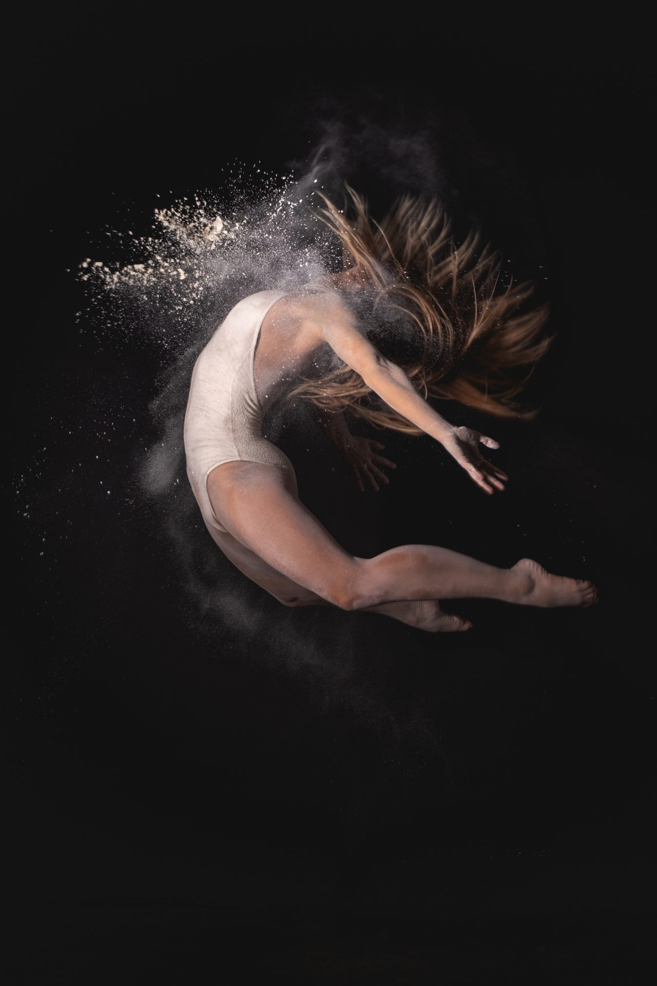 Beautiful dancer Lidia Cramona dancing and jumping with white powder photo by Jo Kassis