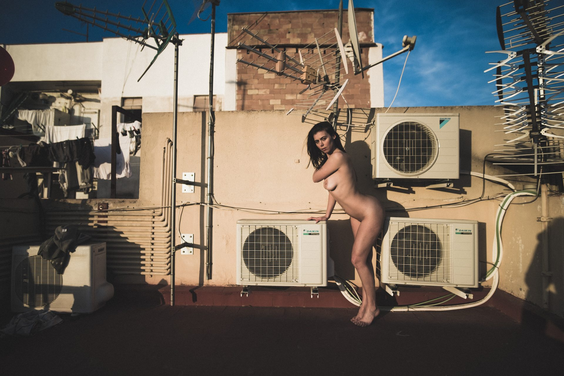 Lemonbahaya natural amateur model posing nude on a rooftop surrounded by AC and antenas photo by Jo Kassis