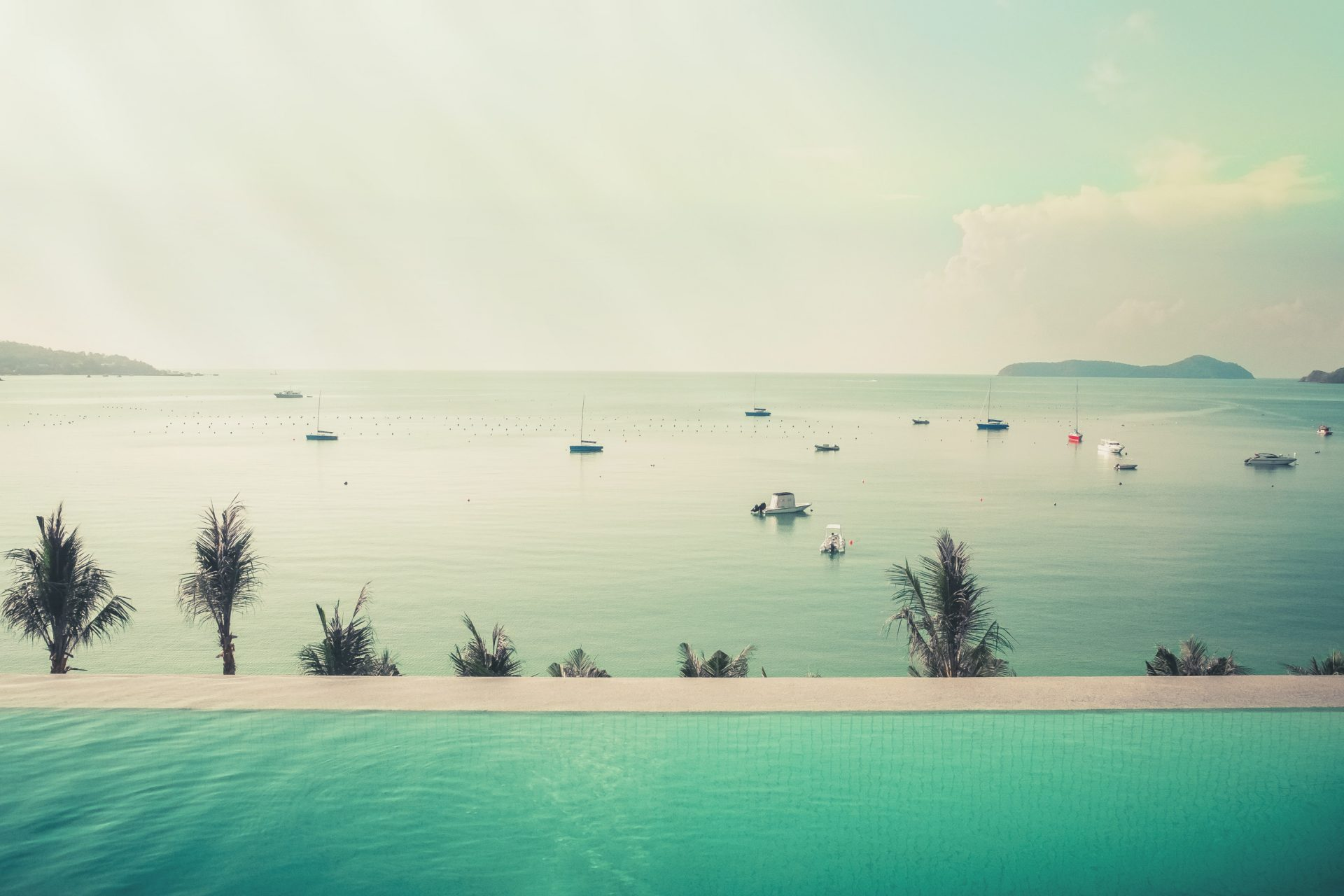 Infinity pool with a view on the sea photo by Jo Kassis