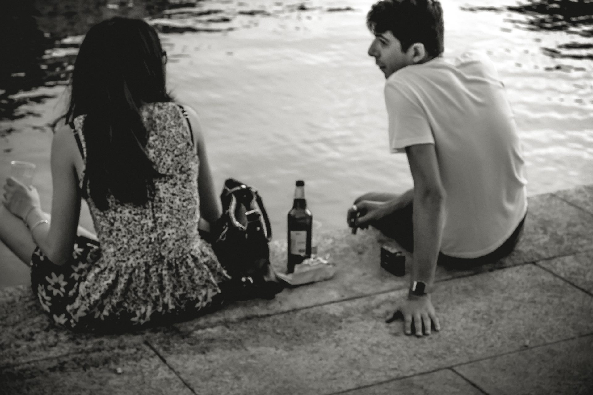 Couple drinking by the river photo by Jo Kassis